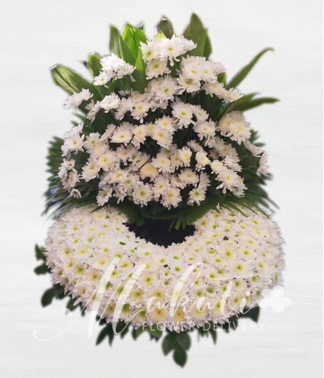 Elegant White Rados Urn Flower Arrangement